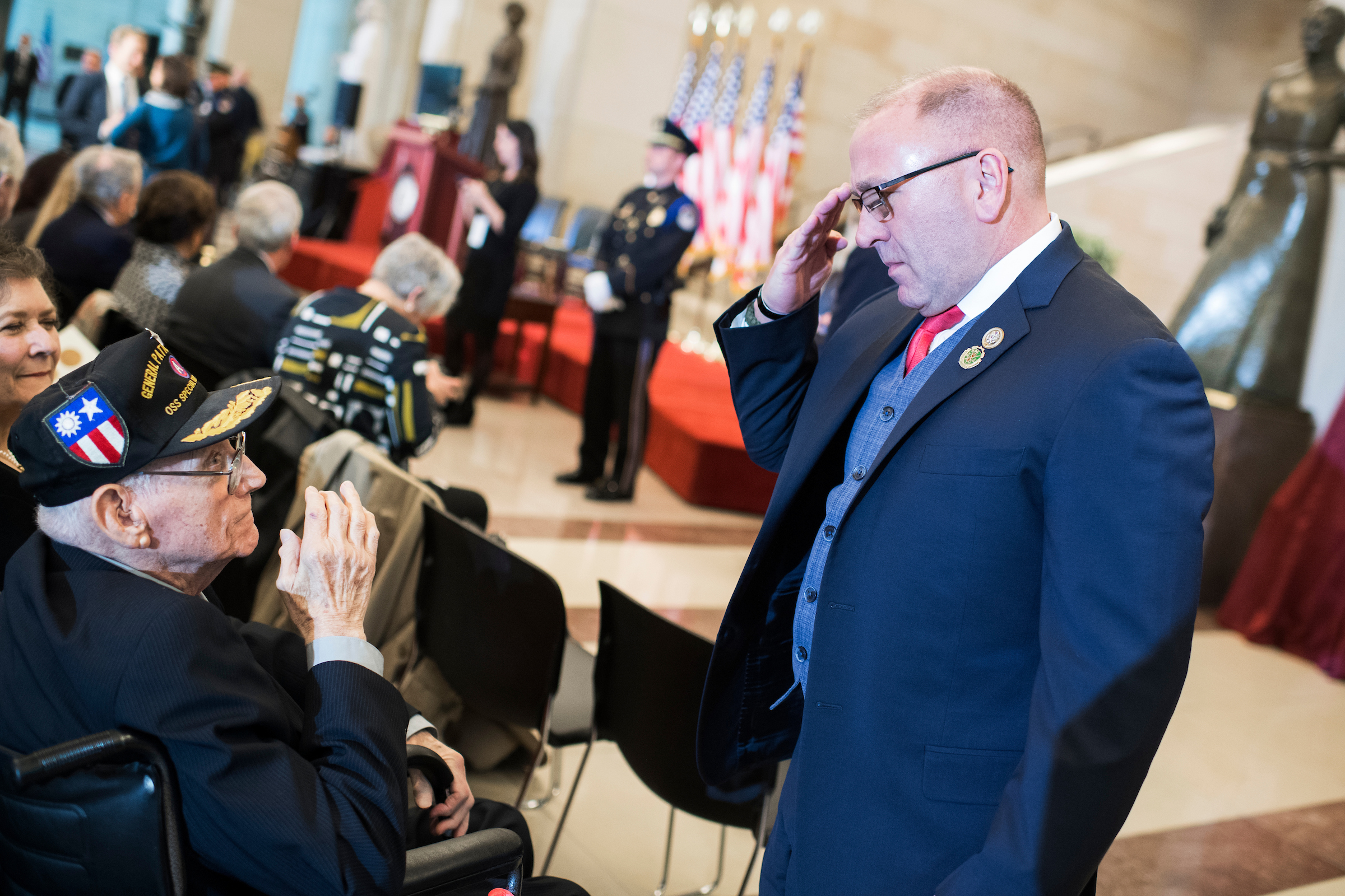 UNITED STATES - MARCH 21: Rep. Clay Higgins, R-La., salutes retired Army Brig. Gen. Robert LeBlanc, 96, of Abbeville, La., before a Congressional Gold Medal ceremony in Emancipation Hall to honor members of the Office of Strategic Services (OSS) on March 21, 2018. General LeBlanc served with the OSS in Europe and China during World War II. (Photo By Tom Williams/CQ Roll Call)