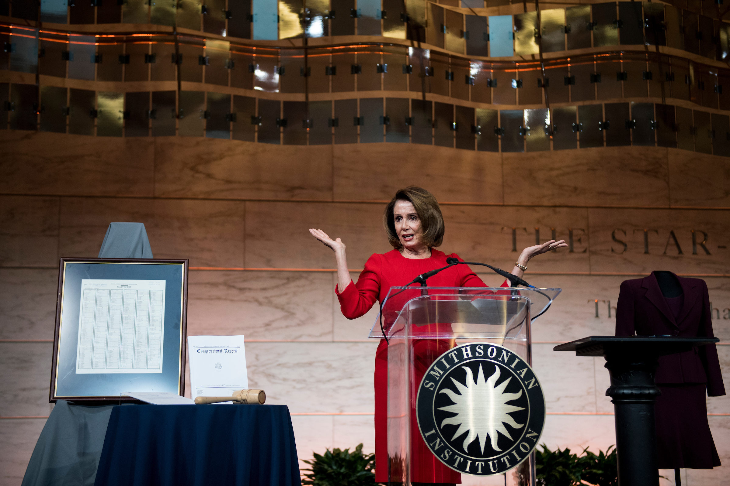 UNITED STATES - MARCH 7: House Minority Leader Nancy Pelosi, D-Calif., speaks at the The National Museum of American History where she donated items representing her term as the first female Speaker of the House on Wednesday, March 7, 2018. Items donated included her gavel, the tally sheet from her election as Speaker and a dress. (Photo By Bill Clark/CQ Roll Call)