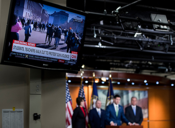 Speaker of the House Paul Ryan, R-Wisc., holds a press conference with House GOP leadership in the Capitol on Wednesday, March 14, 2018, as a television displays live video from student protests against gun violence. (Photo By Bill Clark/CQ Roll Call)