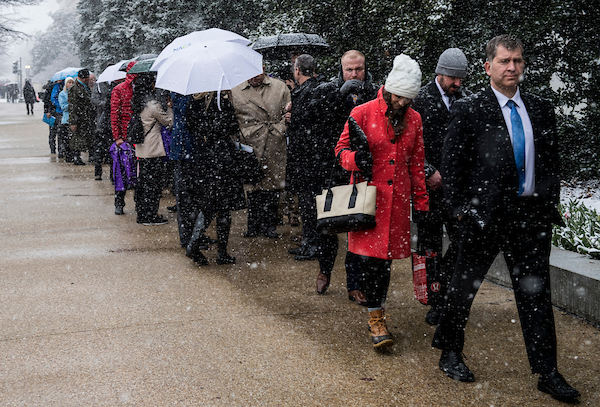 UNITED STATES - MARCH 21: With only two entrances open to the Hart and Dirksen buildings, visitors wait in a long line in the snow to enter the Hart Senate Office Building Wednesday morning, March 21, 2018. (Photo By Bill Clark/CQ Roll Call)