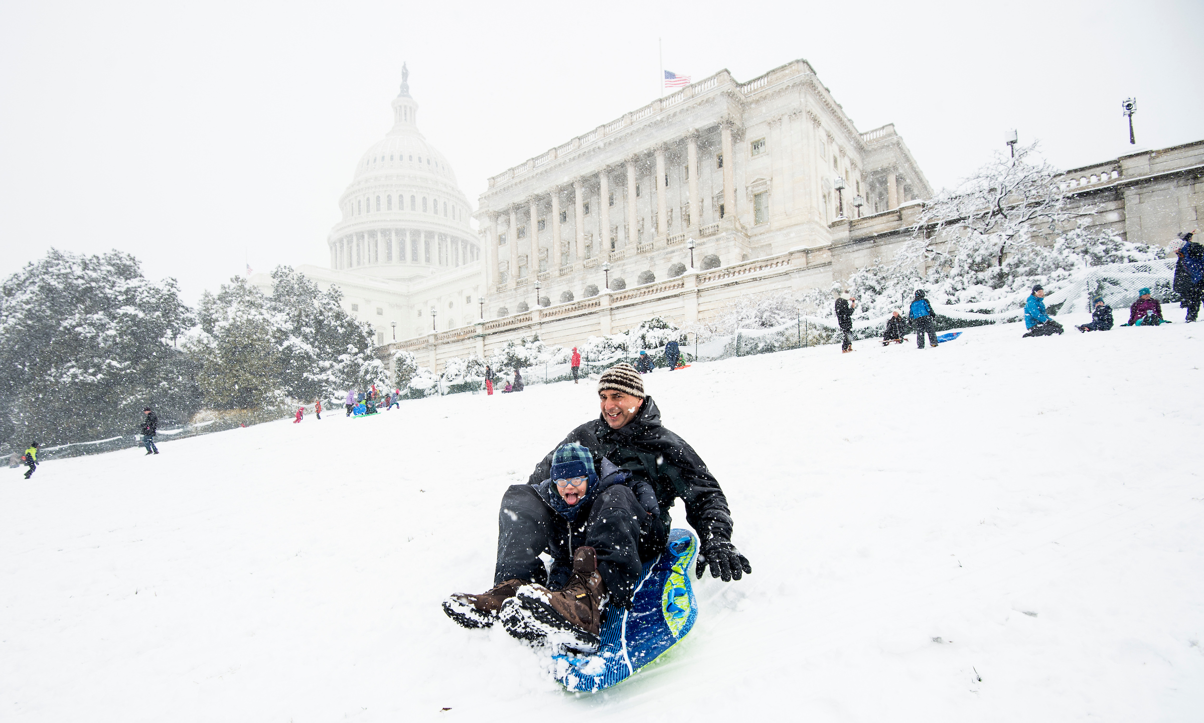 UNITED STATES - MARCH 21: Kids and adults sled down the hill on the west side of the Capitol during the snow storm in Washington on Wednesday, March 21, 2018. (Photo By Bill Clark/CQ Roll Call)