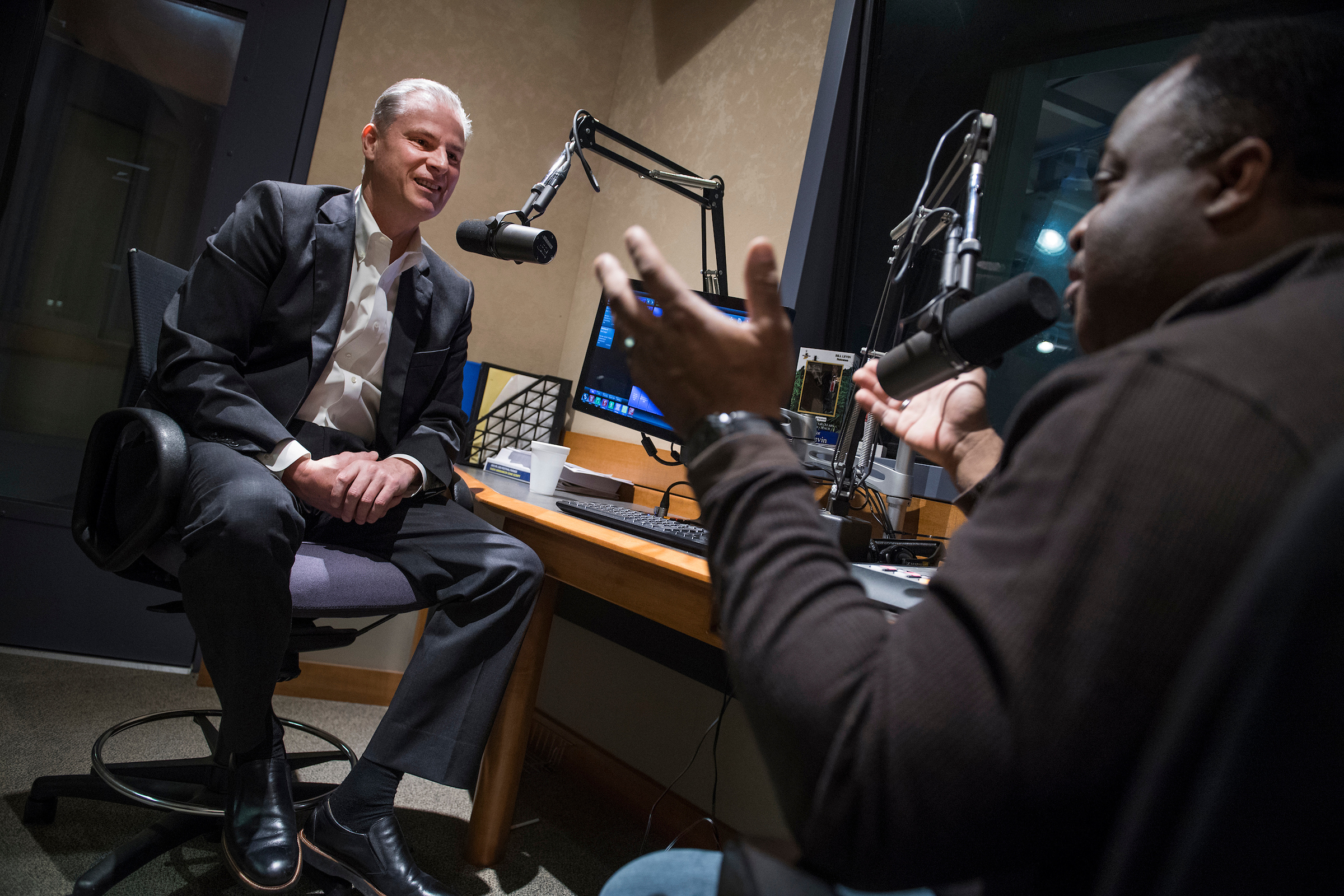 UNITED STATES - APRIL 3: Steve Braun, left, who is running for the Republican nomination for Indiana's 4th Congressional District, is interviewed by Abdul Hakim-Shabazz at WIBC studios in Indianapolis, Ind., on April 3, 2018. (Photo By Tom Williams/CQ Roll Call)