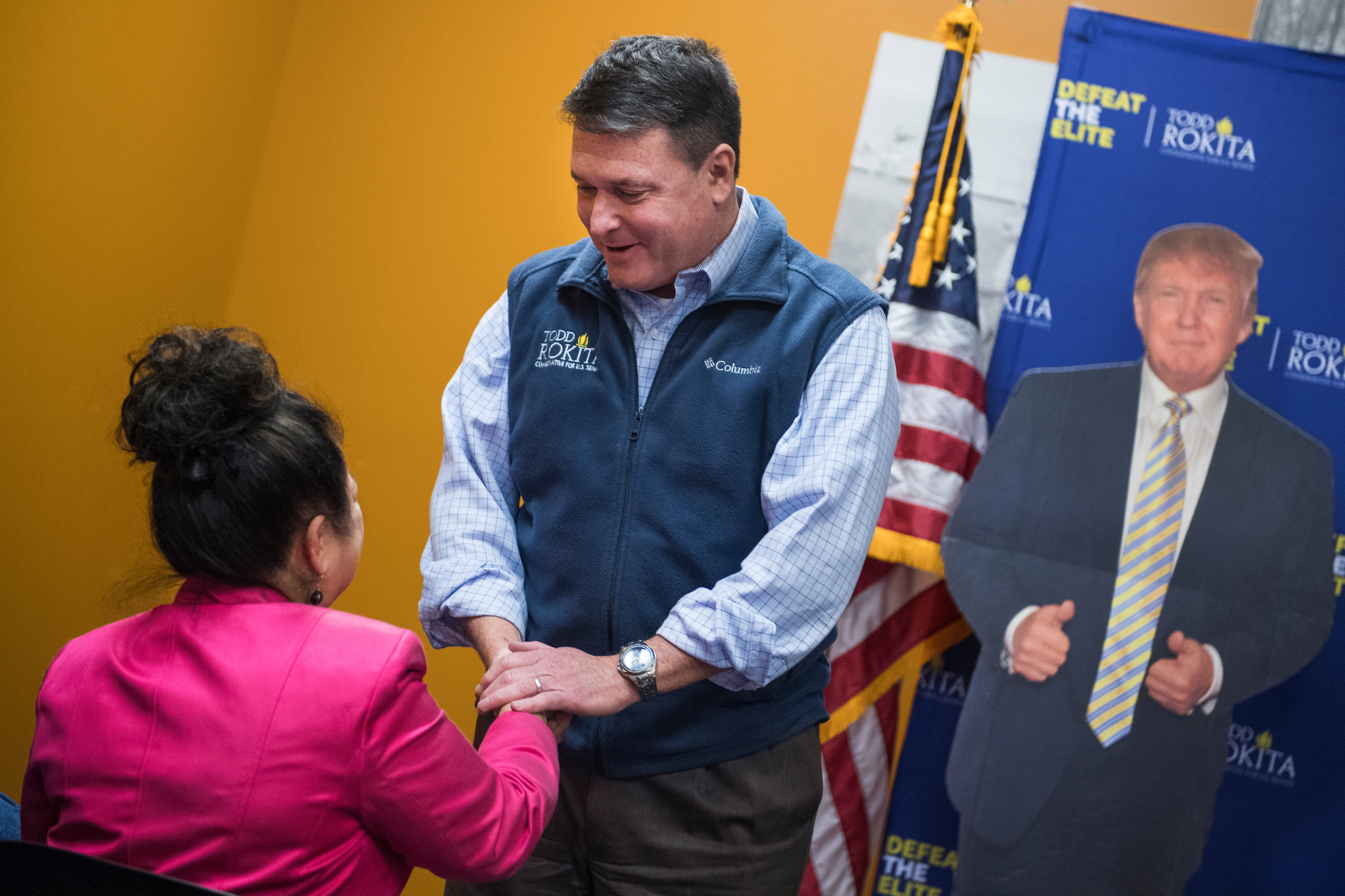 UNITED STATES - APRIL 4: Rep. Todd Rokita, R-Ind., who is running for the Republican nomination for Senate in Indiana, greets Tina Wenger before addressing voters in South Bend, Ind., on April 4, 2018. (Photo By Tom Williams/CQ Roll Call)