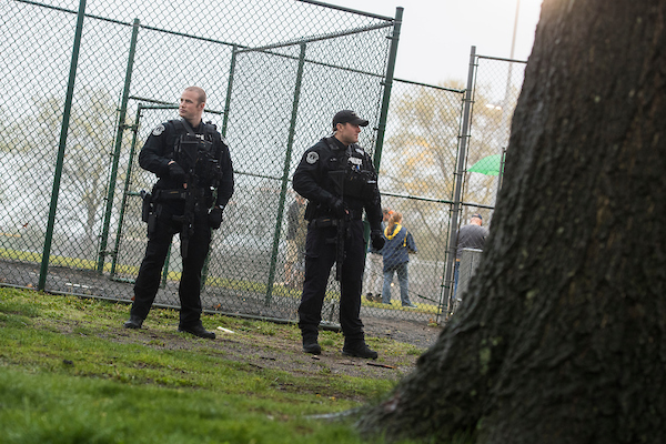 UNITED STATES - APRIL 25: U.S. Capitol Police stand guard at the Republican baseball team's first practice of the year at Eugene Simpson Stadium Park in Alexandria, Va., on April 25, 2018. (Photo By Tom Williams/CQ Roll Call)