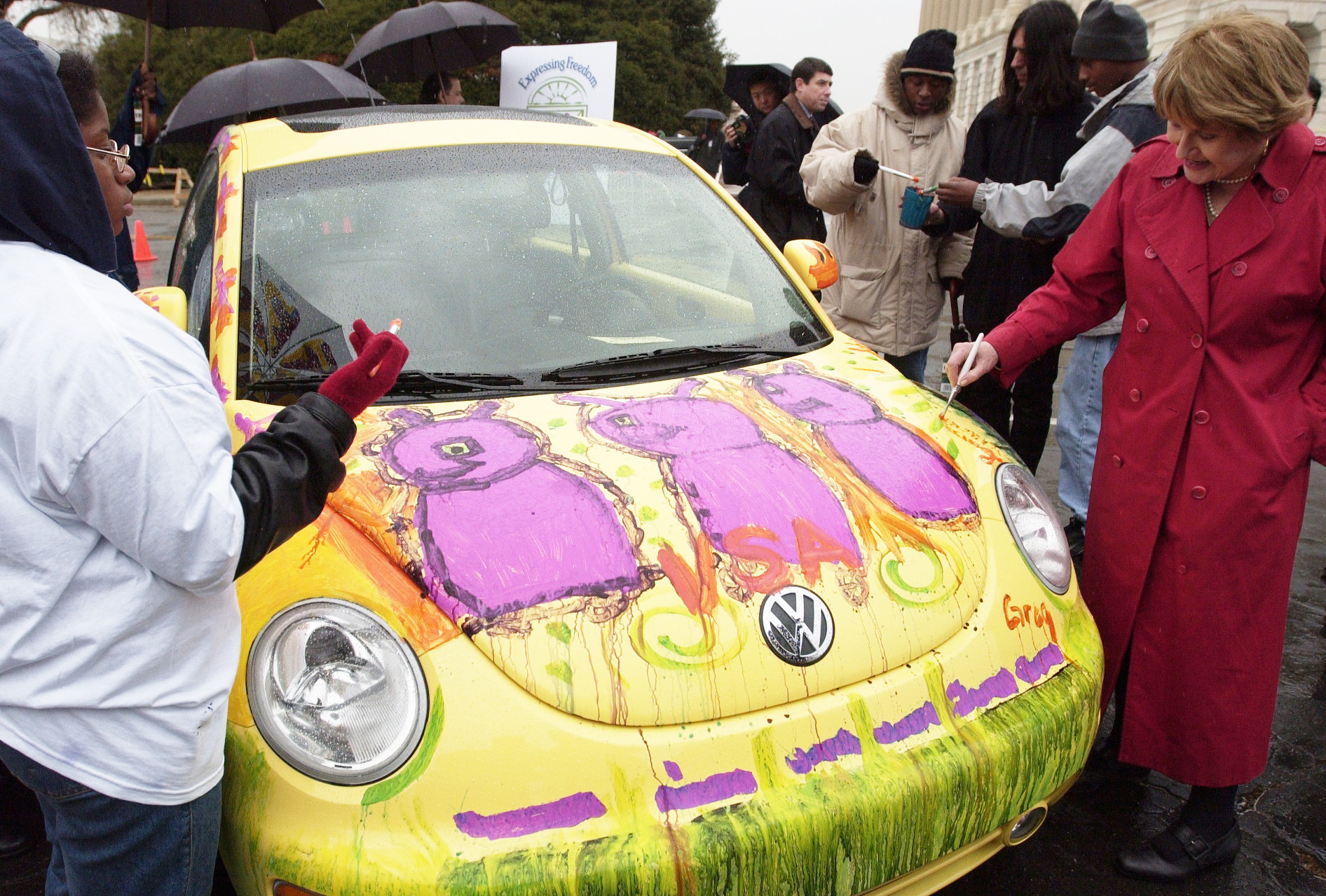 "beetle1/031202 - Rep. Louise Slaughter, Co-Chair, Congressional Arts Caucus, paints a VW New Beetle Congressional Arts Caucus before a press conference to launch ""Expressing Freedom: A National Juried Art Exhibition for Young Artists with Disabilites,"" sponsered by VSA Arts and Volkswagen of America, Inc."