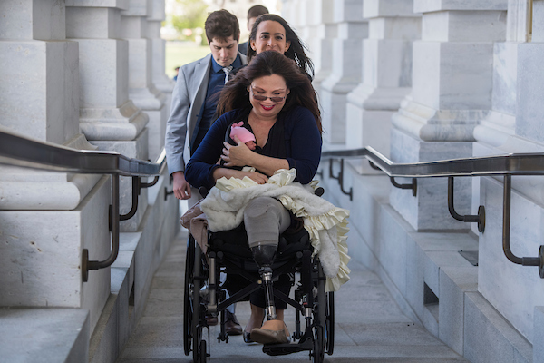 Sen. Tammy Duckworth, D-Ill., brings her baby, Maile Pearl, into the Capitol for a vote on Thursday. Earlier in the week, a resolution was passed to allow infants on the floor for votes. (Tom Williams/CQ Roll Call)