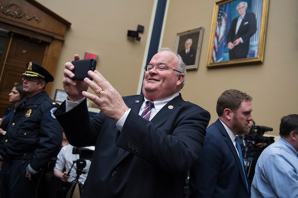 UNITED STATES - APRIL 11: Rep. Billy Long, R-Mo., takes a picture of the media before a House Energy and Commerce Committee in Rayburn Building on the protection of user data featuring testimony by Facebook CEO Mark Zuckerberg on April 11, 2018. (Photo By Tom Williams/CQ Roll Call)