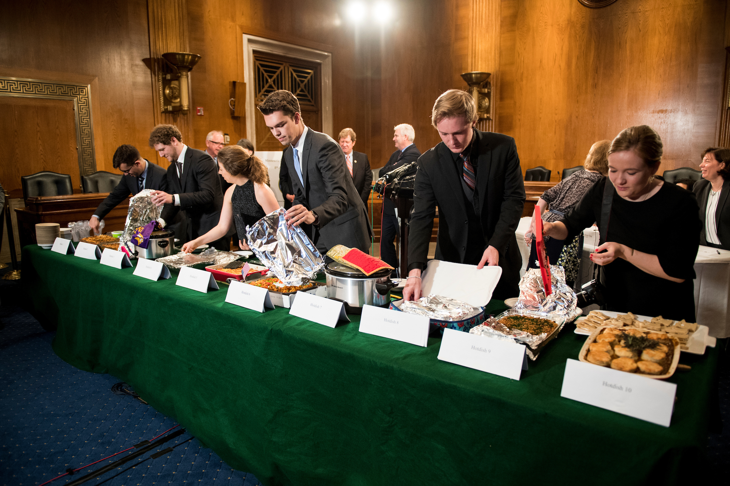 UNITED STATES - APRIL 25: Staffers uncover the dishes during the eighth annual Minnesota Congressional Delegation Hotdish Competition in the Dirksen Senate Office Building on Wednesday, April 25, 2018. (Photo By Bill Clark/CQ Roll Call)