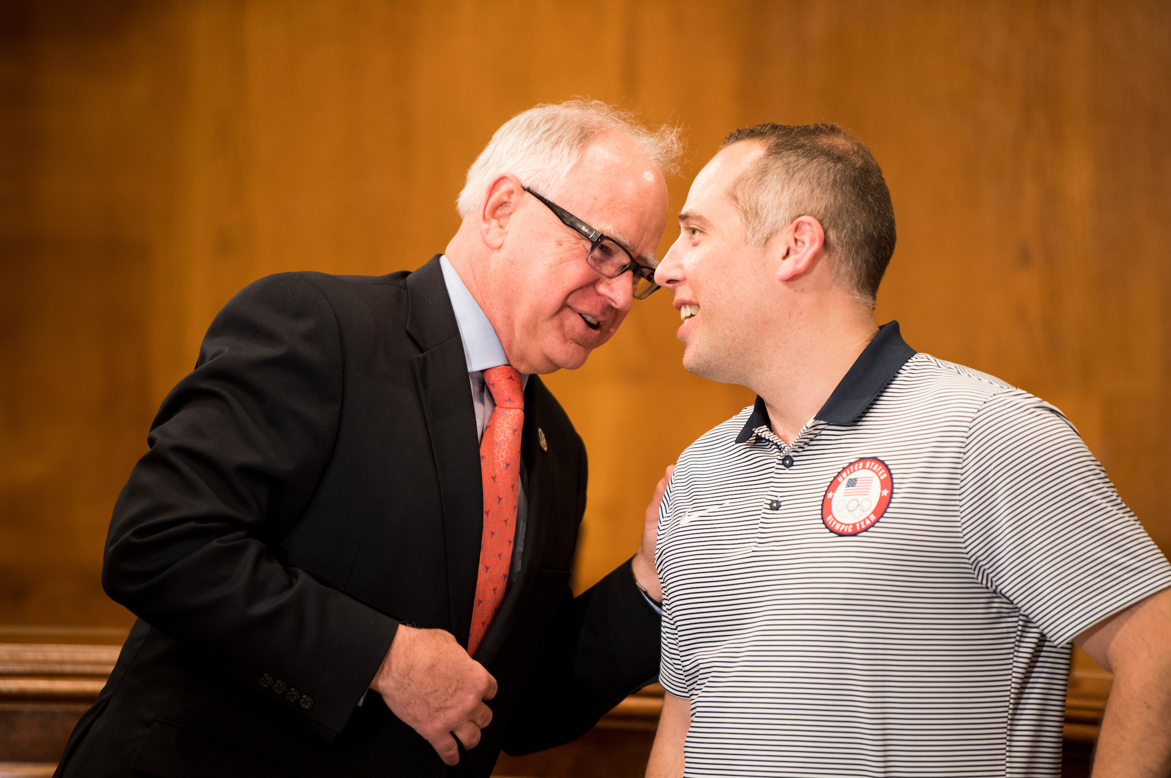 Rep. Tim Walz, D-Minn., left, speaks with judge Phil Drobnick, coach of the US Olympic gold medal curling team, at the eighth annual Minnesota Congressional Delegation Hotdish Competition in the Dirksen Senate Office Building on Wednesday, April 25, 2018. (Photo By Bill Clark/CQ Roll Call)