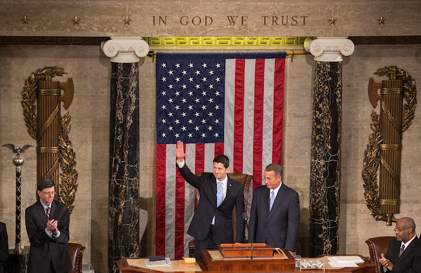 Incoming Speaker Ryan waves to members of Congress alongside outgoing Speaker John A. Boehner, R-Ohio, in the House chambers of the U.S. Capitol in Washington, on October 29, 2015. (Al Drago/CQ Roll Call file photo)