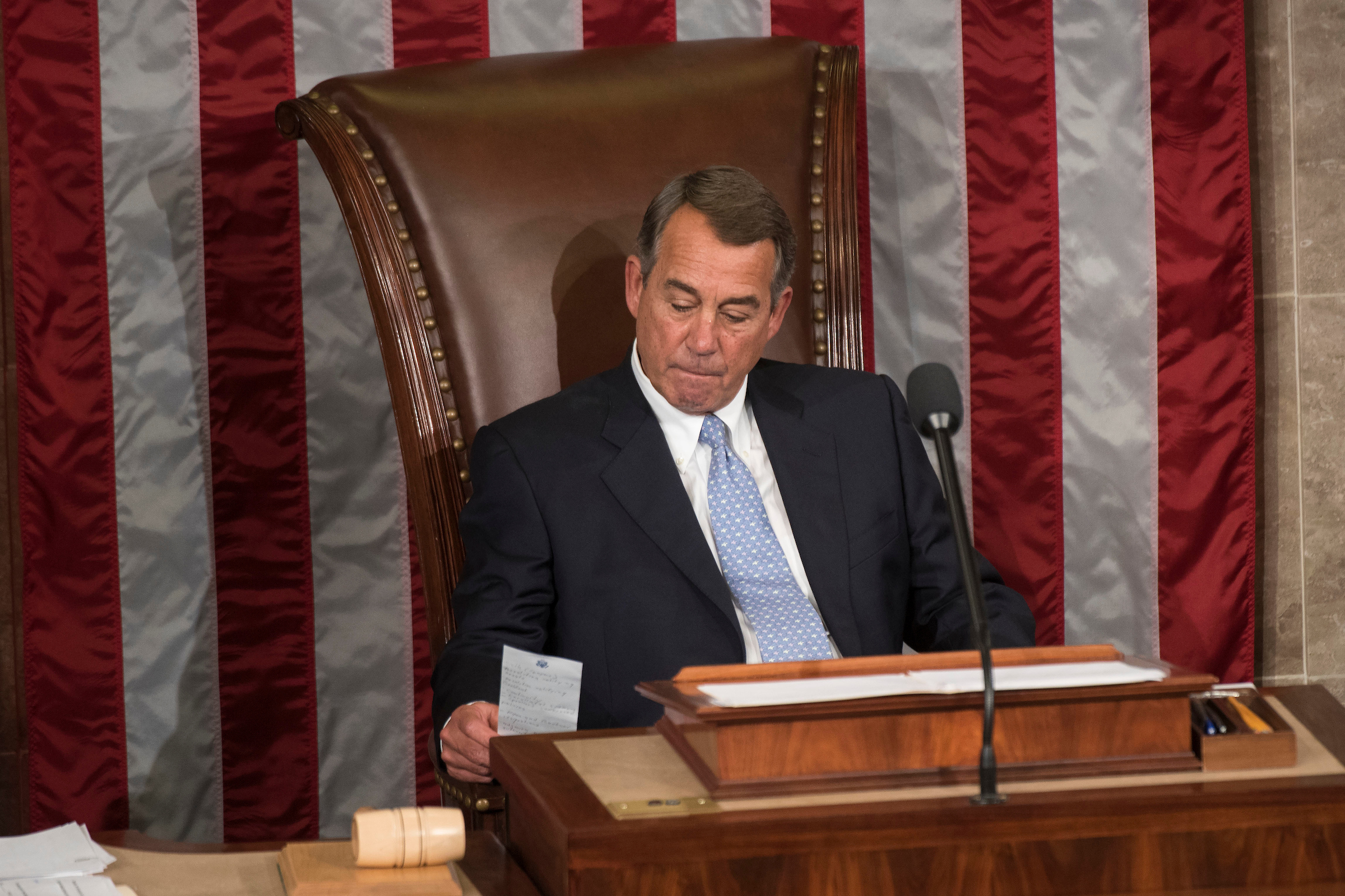 Outgoing Speaker John Boehner, R-Ohio, looks at his notes while waiting for a vote on the new Speaker in the House Chamber of the U.S. Capitol in Washington. (Drago/CQ Roll Call File Photo)