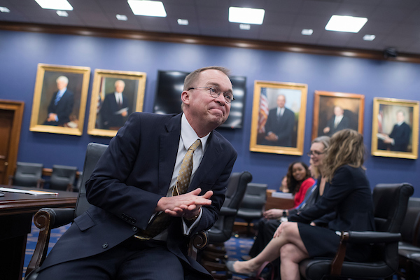 UNITED STATES - APRIL 18: Office of Management and Budget Director Mick Mulvaney prepares to testify before a House Appropriations Financial Services and General Government Subcommittee hearing in Rayburn Building on the FY2019 Budget for OMB on April 18, 2018. (Photo By Tom Williams/CQ Roll Call)