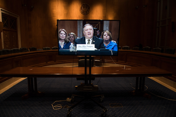 UNITED STATES - APRIL 12: CIA Director Mike Pompeo, nominee for secretary of state, appears in a monitor in a overflow room during his Senate Foreign Relations Committee confirmation hearing in Dirksen Building on April 12, 2018. (Photo By Tom Williams/CQ Roll Call)