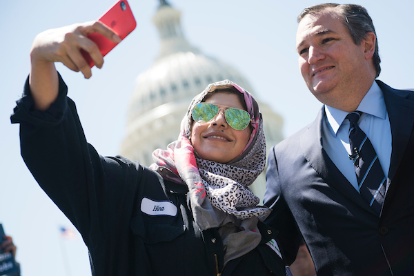 "UNITED STATES - APRIL 26: Sen. Ted Cruz, R-Texas, takes a selfie with Hina Kanwel, of Monroe Energy, during a news conference on ""finding a win-win solution for both corn farmers and refinery workers, who face skyrocketing RINs (renewable identification numbers) prices under the renewable fuel standard,"" on the east lawn of the Capitol on April 26, 2018. (Photo By Tom Williams/CQ Roll Call)"