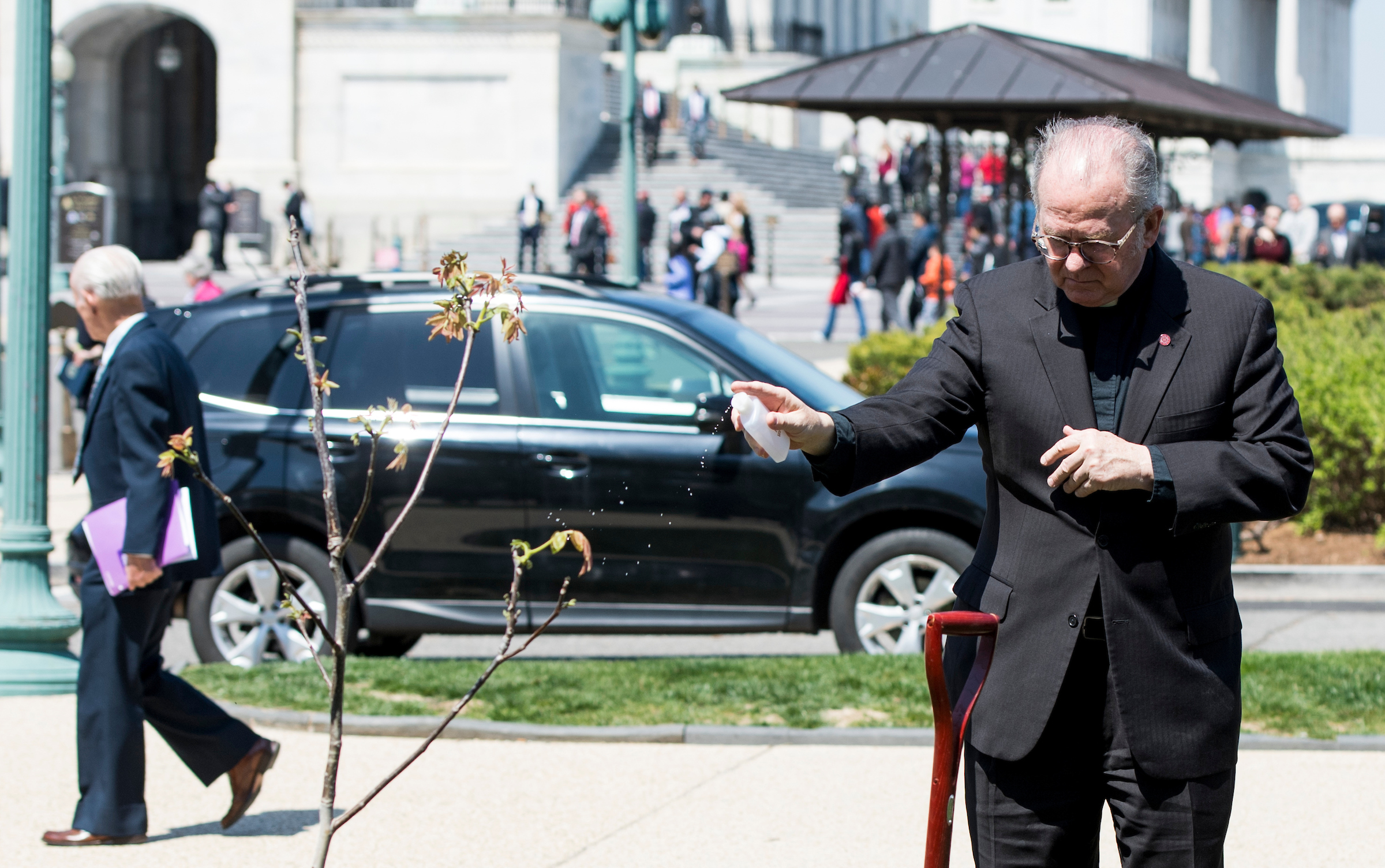 UNITED STATES - APRIL 18: Rev. Patrick J. Conroy, chaplain of the U.S. House of Representatives, blesses the walnut tree during the tree planting ceremony in memory of Rep. Louise Slaughter, D-N.Y., on Wednesday, April 18, 2018. (Photo By Bill Clark/CQ Roll Call)