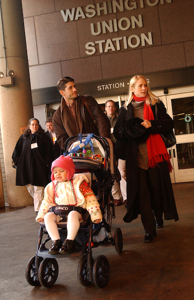Ryan, his wife Janna, and daughter Elizabeth, 2, make their way to a train at Union Station, that will take them to the Republican Bicameral retreat in Philadelphia. (CQ Roll Call archive photo)