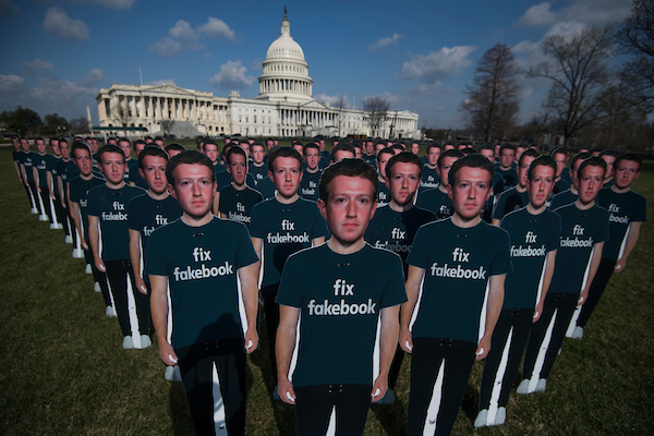 Cutouts of Facebook CEO Mark Zuckerberg appear on the East Lawn of the Capitol ahead of his testimony on Tuesday before a joint Senate hearing on the protection of user data. The group Avaaz set up the display to call on Facebook to delete fake accounts. (Tom Williams/CQ Roll Call)