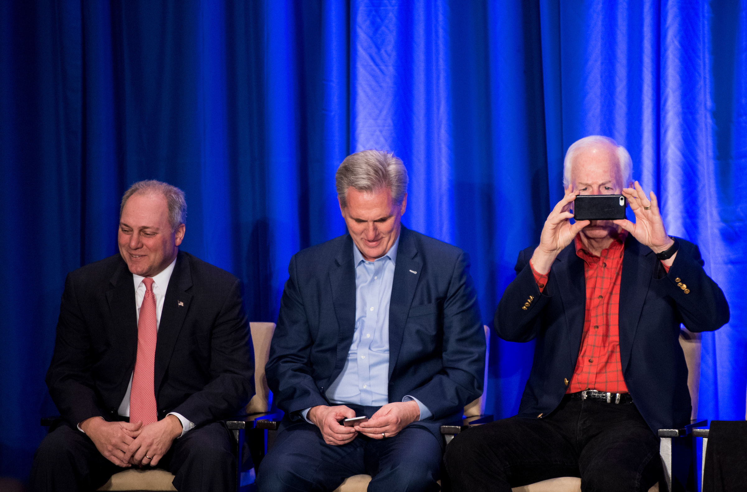 UNITED STATES - JANUARY 26: From left, House Majority Whip, Steve Scalise, R-La., House Majority Leader Kevin McCarthy, R-Calif., and Sen. John Cornyn, R-Texas, sit on stage while waiting for President Donald Trump to address the GOP retreat in Philadelphia on Thursday, Jan. 26, 2017. House and Senate Republicans are holding their retreat through Friday in Philadelphia. (Photo By Bill Clark/CQ Roll Call)