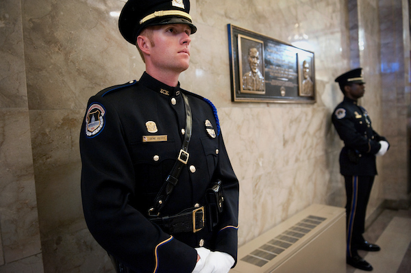 UNITED STATES - JULY 24: U.S. Capitol Police Officer Gene Petty stands on ceremonial duty before an annual wreath-laying ceremony for U.S. Capitol Police Officer Jacob J. Chestnut and Detective John M. Gibson, killed by a gunman while on duty in 1998. The ceremony took place at an entrance to the Capitol dedicated to the slain officers. (Photo By Chris Maddaloni/CQ Roll Call) 2012