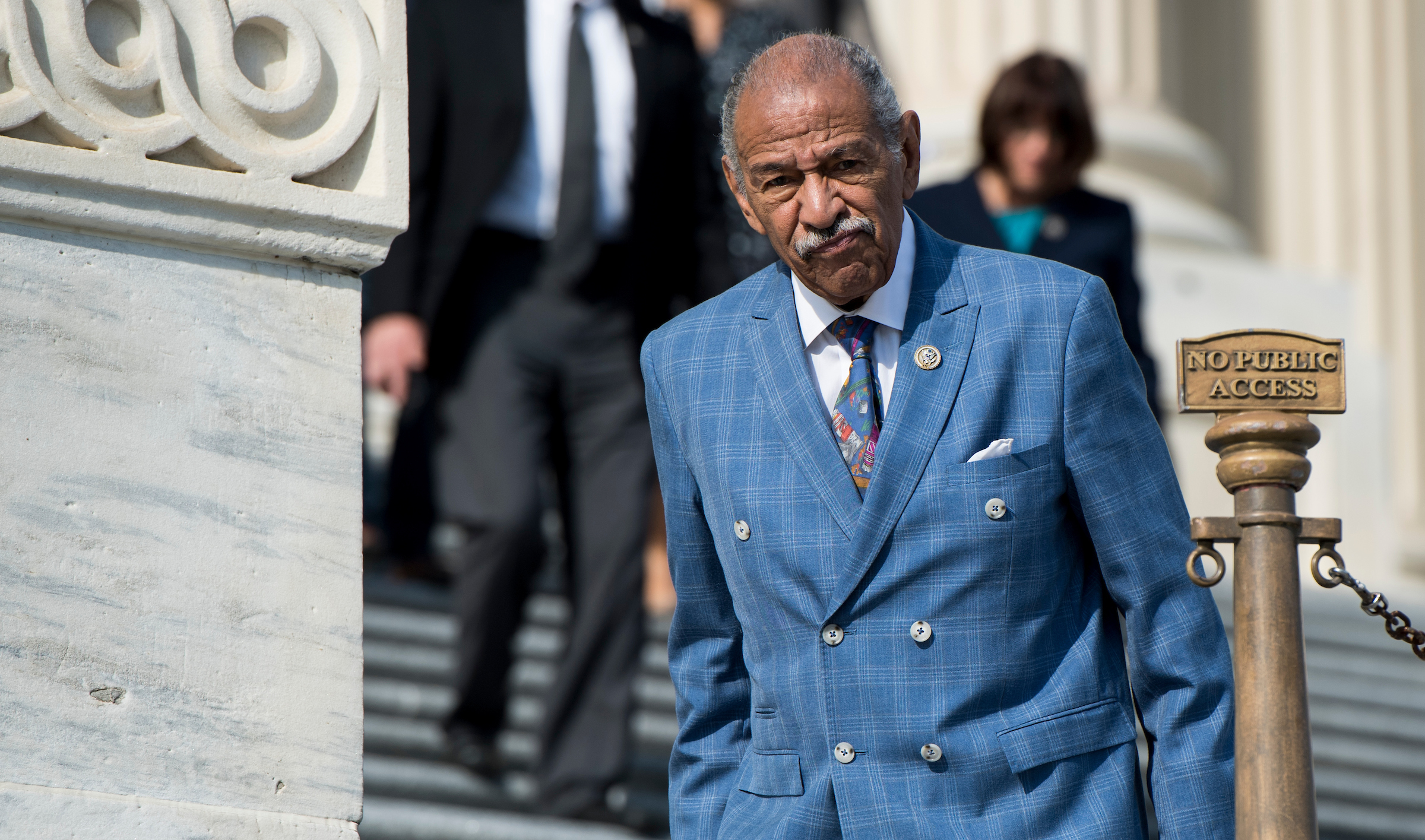 Rep. John Conyers, D-Mich., walks down the House steps after voting in the Capitol. (Bill Clark/CQ Roll Call File Photo)