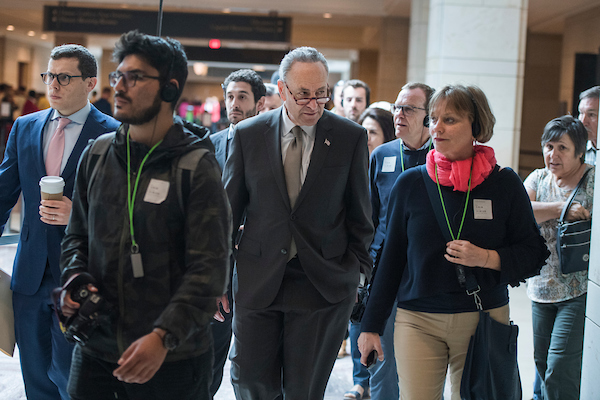 UNITED STATES - MAY 10: Senate Minority Leader Charles Schumer, D-N.Y., makes his way through the Capitol Visitor Center after a news conference with House and Senate Democrats on a report which they say shows that prescription drug prices have risen under President Trump on May 10, 2018. (Photo By Tom Williams/CQ Roll Call)