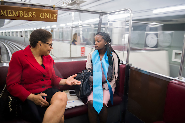 UNITED STATES - MAY 23: Megan Simon, 25, of Los Angeles, talks with Rep. Karen Bass, D-Calif., in the Rayburn subway during the Foster Youth Shadow Day on May 23, 2018. (Photo By Tom Williams/CQ Roll Call)