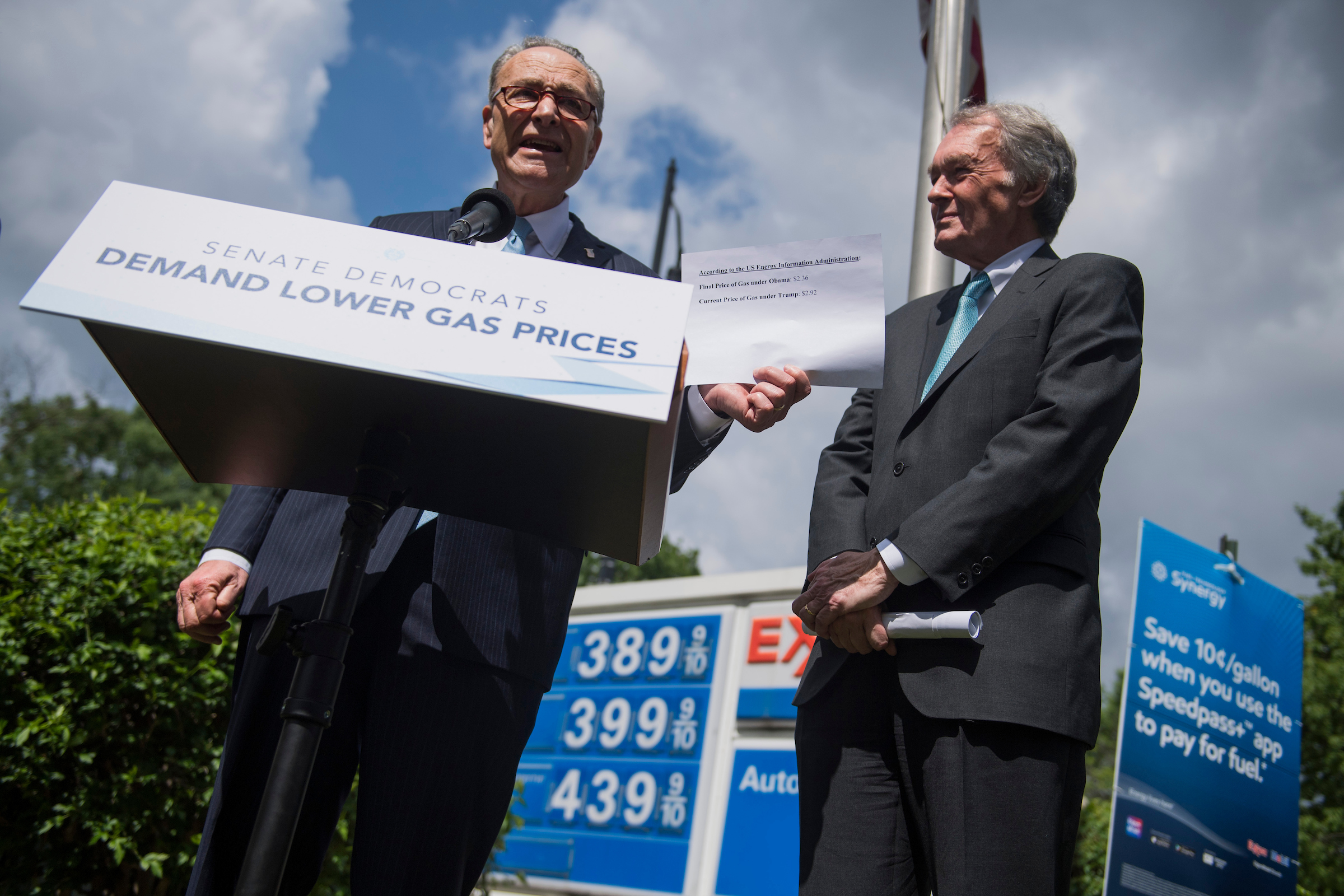 UNITED STATES - MAY 23: Senate Minority Leader Charles Schumer, D-N.Y., left, and Sen. Ed Markey, D-Mass., conduct a news conference at the Exxon gas station at Massachusetts Avenue and 2nd Street, NE, to urge President Trump to take action to lower gas prices on May 23, 2018. Schumer holds a statistic indicating that gas prices were lower under President Obama. (Photo By Tom Williams/CQ Roll Call)