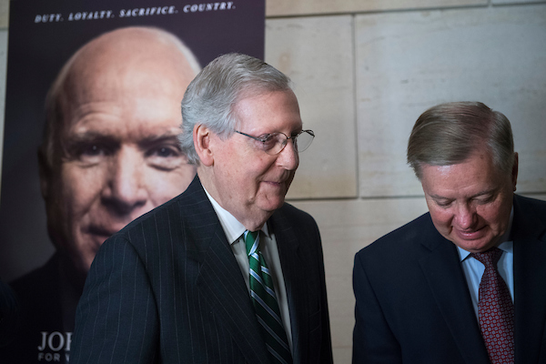 "UNITED STATES - MAY 17: Senate Majority Leader Mitch McConnell, R-Ky., left, and Sen. Lindsey Graham, R-S.C., attend a reception in the Capitol Visitor Center before a film screening of HBO's documentary ""John McCain: For Whom The Bell Tolls,"" on May 17, 2018. (Photo By Tom Williams/CQ Roll Call)"