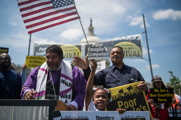 "UNITED STATES - MAY 21: Revs. William Barber, left, Jesse Jackson, and Romiah Short, 7, attend a rally on the east front lawn of the Capitol with members of the Poor People's Campaign to call on lawmakers to address the ""connection between systemic racism, poverty and voter suppression,"" May 21, 2018. (Photo By Tom Williams/CQ Roll Call)"