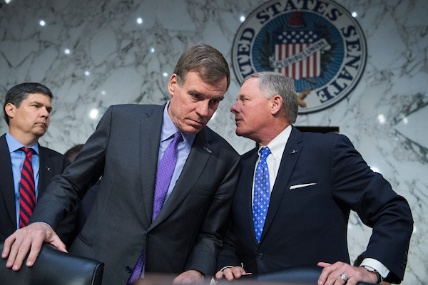 Chairman Richard Burr, R-N.C., right, and ranking member Sen. Mark Warner, D-Va., arrive for the Senate (Select) Intelligence Committee confirmation hearing for Gina Haspel, nominee to be director of the CIA, in Hart Building with former Sens. Saxby Chambliss, R-Ga., left, and Evan Bayh, D-Ind., who introduced her, on May 9, 2018. (Photo By Tom Williams/CQ Roll Call)