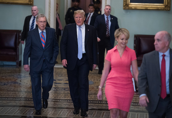 UNITED STATES - MAY 15: President Donald Trump, center, and Senate Majority Leader Mitch McConnell, R-Ky., arrive for the Senate Republican Policy luncheon in the Capitol on May 15, 2018. (Photo By Tom Williams/CQ Roll Call)