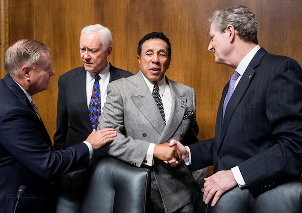 "UNITED STATES - MAY 15: From left, Sen. Lindsey Graham, R-S.C., Sen. Orrin Hatch, R-Utah, recording artist Smokey Robinson, and Sen. John Kennedy, R-La., talk before the start of the Senate Judiciary Committee hearing on ""Protecting and Promoting Music Creation for the 21st Century"" on Tuesday, May 15, 2018. (Photo By Bill Clark/CQ Roll Call)"