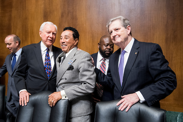 "UNITED STATES - MAY 15: From left, Sen. Orrin Hatch, R-Utah, recording artist Smokey Robinson, and Sen. John Kennedy, R-La., pose for the cameras before the start of the Senate Judiciary Committee hearing on ""Protecting and Promoting Music Creation for the 21st Century"" on Tuesday, May 15, 2018. (Photo By Bill Clark/CQ Roll Call)"