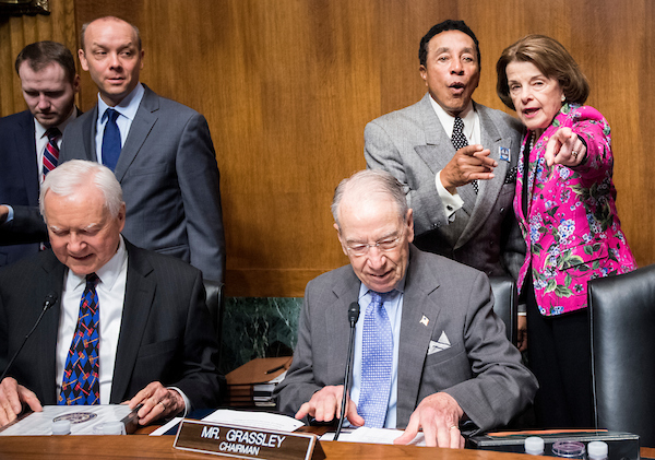 "Sen. Dianne Feinstein, D-Calif., points recording artist Smokey Robinson to his seat at the witness table as Sen. Orrin Hatch, R-Utah, and Sen. Chuck Grassley, R-Iowa, take their seats before the start of the Senate Judiciary Committee hearing on ""Protecting and Promoting Music Creation for the 21st Century"" on Tuesday, May 15, 2018. (Photo By Bill Clark/CQ Roll Call)"