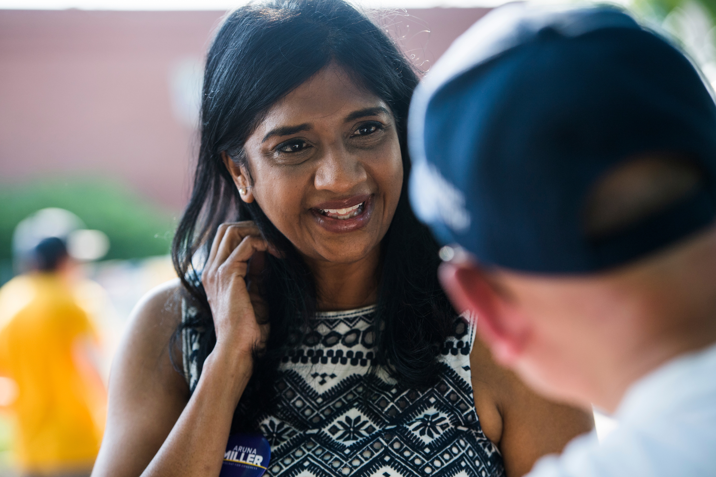 UNITED STATES - JUNE 18: Aruna Miller, who is running for the Democratic nomination in Maryland's 6th Congressional District, talks with citizens during early voting at the Activity Center at Bohrer Park in Gaithersburg, Md., on June 18, 2018. (Photo By Tom Williams/CQ Roll Call)