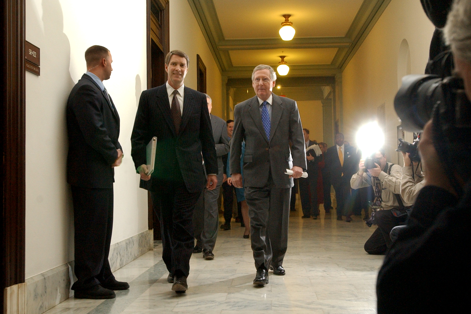 Frist2/010603 - Senate Majoriy Leader Bill Frist, R-Tenn., left, and Majority Whip Sen. Mitch McConnell, R-Ky., walk to the first meeting of the Republican Leadership, Monday, in Russell Building