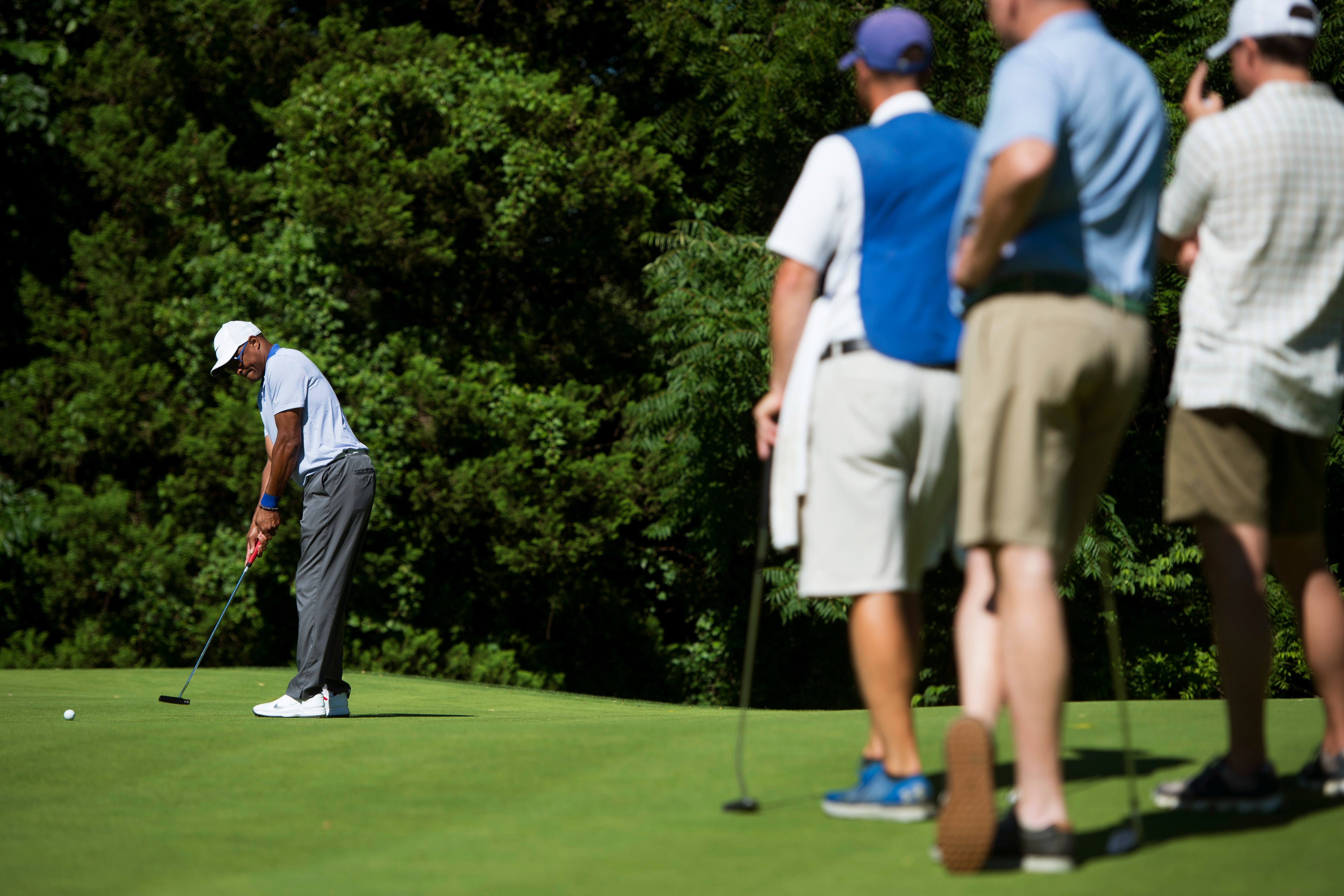 UNITED STATES - June 25: Rep. Cedric Richmond D-La., puts the ball as Reps. Tom Rooney, R-Fla., and Duncan D. Hunter R-Cali., watch nearby during the First Tee's Congressional Challenge annual golf tournament at the Columbia Country Club golf course Monday June 25, 2018 (Photo By Sarah Silbiger/CQ Roll Call)
