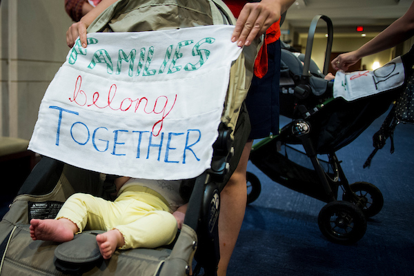 "UNITED STATES - June 19: A group of mothers and their children protesting the separation of families at the southern border are escorted out of the ""Oversight of the FBI and DOJ Actions in Advance of the 2016 Election"" hearing held in front of the House Oversight and Government Reform and House Judiciary Committees Tuesday June 19, 2018. (Photo By Sarah Silbiger/CQ Roll Call)"