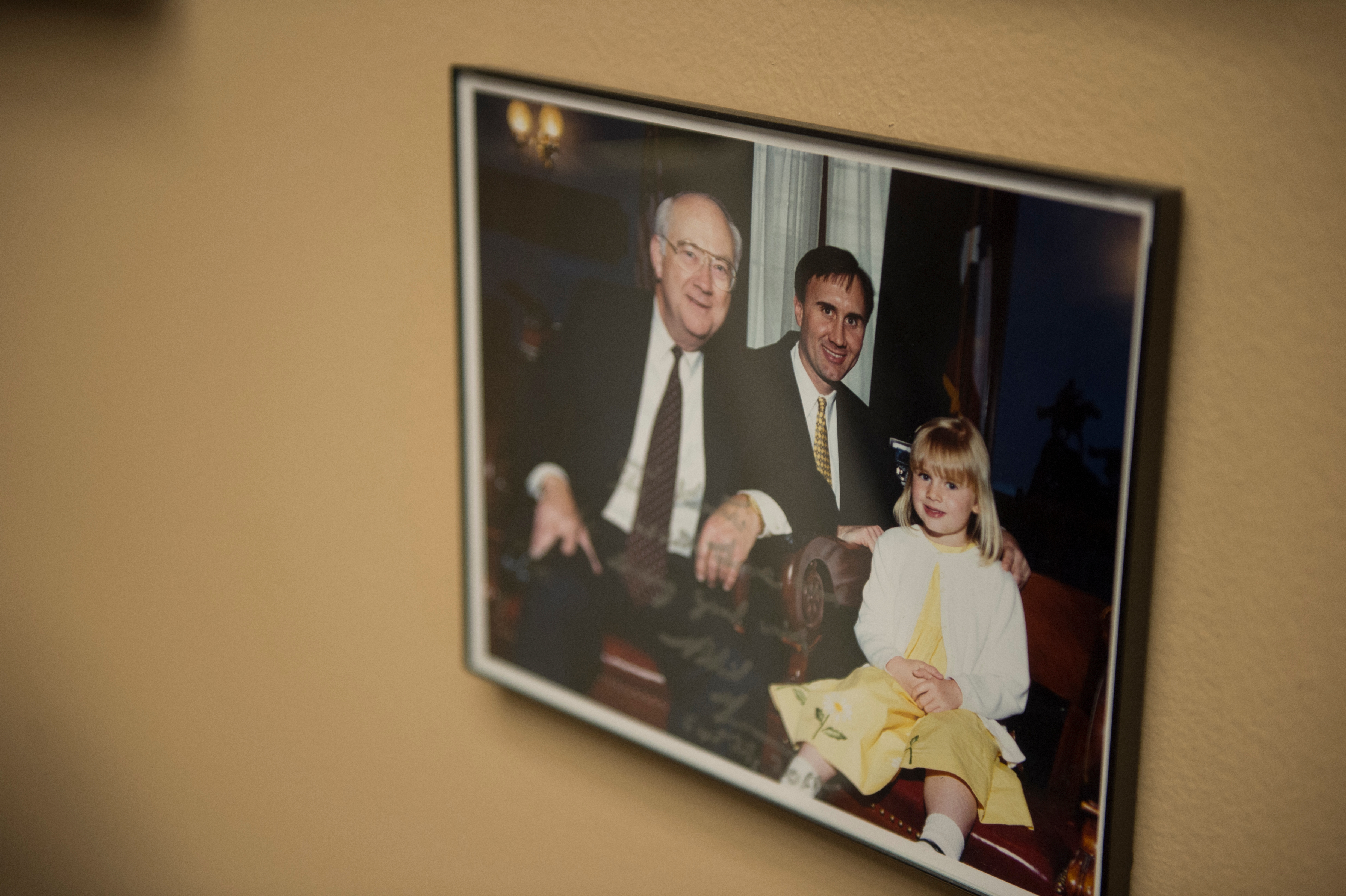 A photo is seen in the office of Rep. Pete Olson, R-Texas, featuring himself, his daughter and former Sen. Phil Gramm, R-Texas, taken in 2000. (Photo By Sarah Silbiger/CQ Roll Call)
