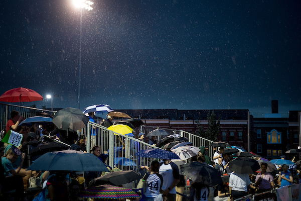 UNITED STATES - June 20: Fans watch in the rain as members of the press and congress play each other during the Congressional Women's Softball Game at the Watkins Recreation Center in Capitol Hill Wednesday June 20, 2018. (Photo By Sarah Silbiger/CQ Roll Call)