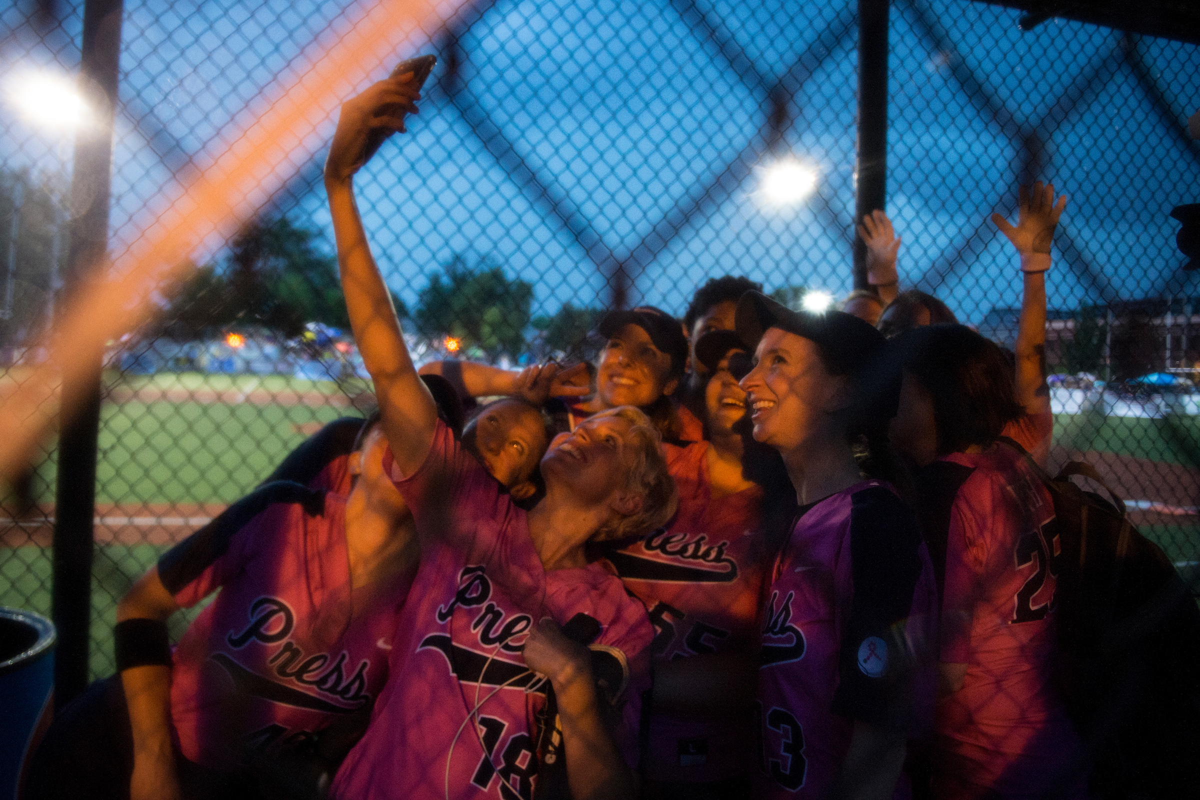 UNITED STATES - June 20: Team Bad News Babes, comprised of members of the press, take a selfie in their dugout after winning the Congressional Women's Softball Game at the Watkins Recreation Center in Capitol Hill Wednesday June 20, 2018. (Photo By Sarah Silbiger/CQ Roll Call)