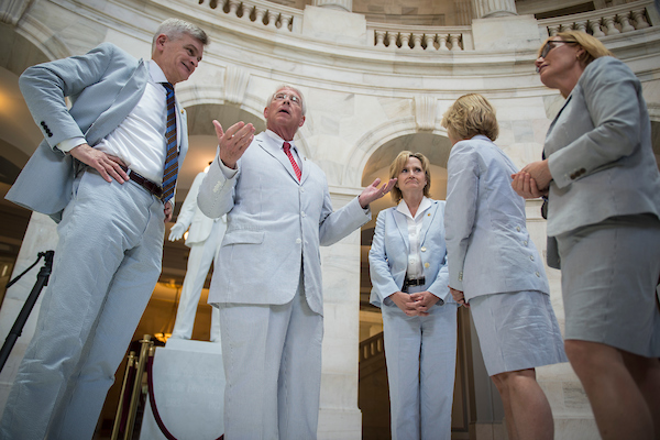 Senators Bill Cassidy, R-La., Roger Wicker, R-Miss., Cindy Hyde-Smith, R-Miss., Shelley Moore, R-W.Va., and Maggie Hassan, D-N.H., gather for a photo on Seersucker Thursday in the Russell Senate Office Building rotunda to celebrate National Seersucker Day June 7, 2018. (Photo By Sarah Silbiger/CQ Roll Call)