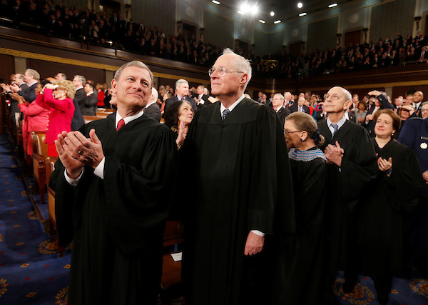 U.S. Supreme Court Chief Justice John Roberts (L) applauds with fellow Justices Anthony Kennedy (2nd from L), Ruth Bader Ginsburg, Stephen Breyer and Elena Kagan (R) prior to President Barack Obama's State of the Union speech on Capitol Hill in Washington, January 28, 2014. REUTERS/Larry Downing (UNITED STATES - Tags: POLITICS)