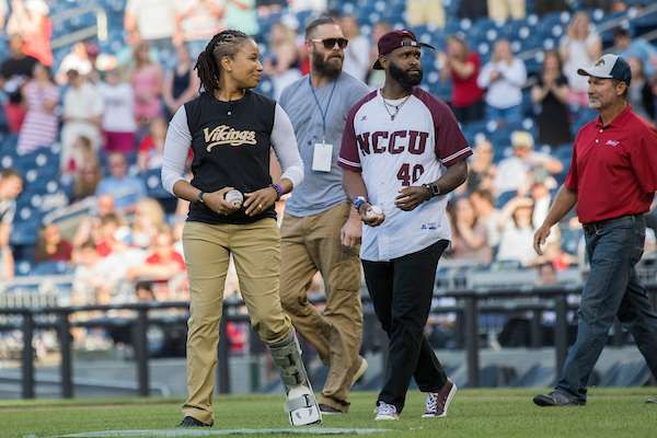 UNITED STATES - JUNE 14: U.S. Capitol Police Special Agents David Bailey and Crystal Griner, and former Washington National Jayson Werth, prepare for the first pitch during the 57th annual Congressional Baseball Game at Nationals Park on June 14, 2018. The Democrats prevailed 21-5. Bailey and Griner helped neutralize the shooter last year. (Photo By Tom Williams/CQ Roll Call)
