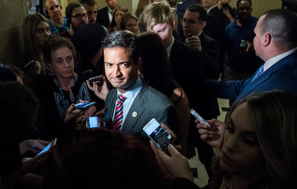 UNITED STATES - JUNE 21: Rep. Carlos Curbelo, R-Fla., speaks with reporters as he leaves Speaker Ryan's office on Thursday, June 21, 2018, as House GOP leadership tries to find a path to pass immigration legislation. (Photo By Bill Clark/CQ Roll Call)