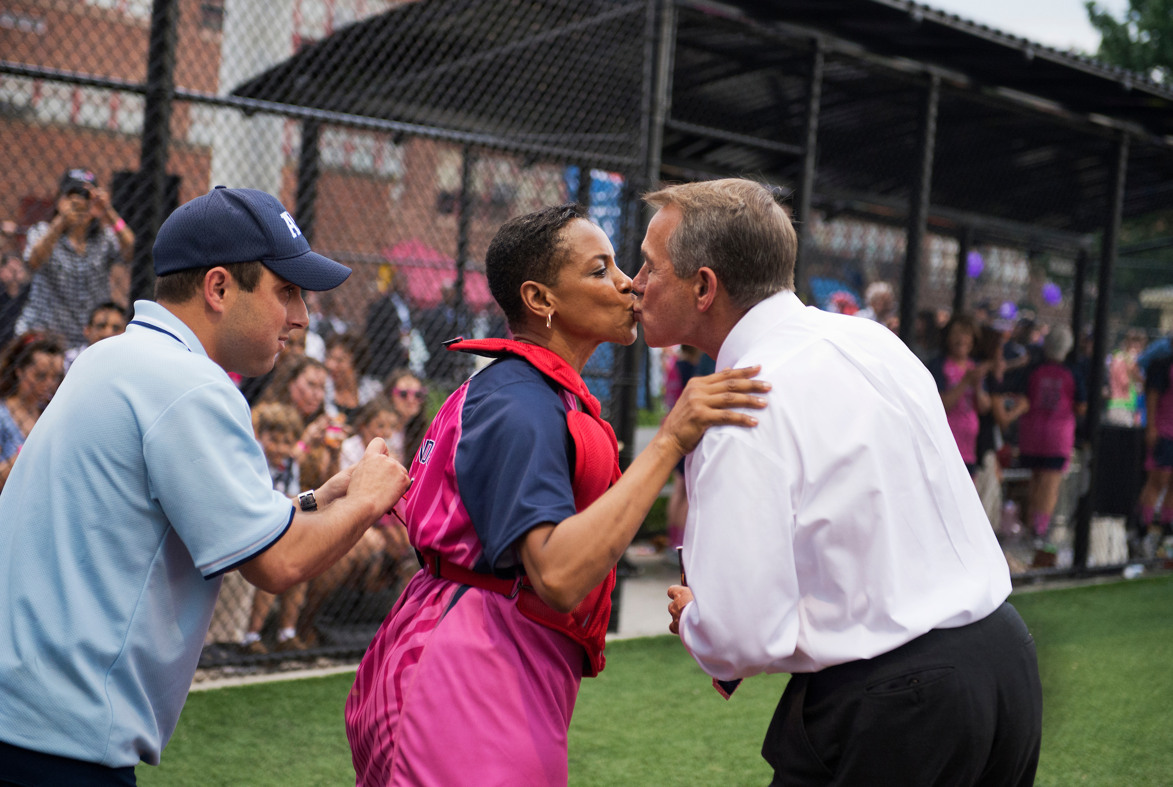 Speaker John Boehner, right, kisses Rep. Donna Edwards at the 2013 game. (Tom Williams/CQ Roll Call)