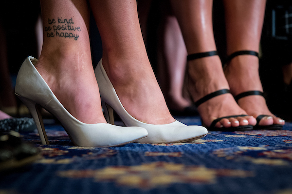 "UNITED STATES – JULY 24: A tattoo reading, ""be kind be positive be happy"" is seen on the ankle of a survivor of sexual abuse by Larry Nassar in the USA gymnastics during a press conference in the Kennedy Caucus Room in the Russell Senate Office Building Tuesday July 24, 2018. Over 80 victims were joined by Senate Democrats to discuss ways to prevent further abuse. (Photo By Sarah Silbiger/CQ Roll Call)"