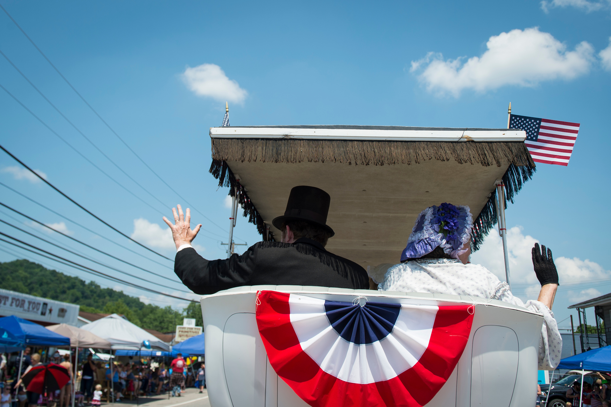 UNITED STATES - July 4: A man dressed as President Abraham Lincoln waves to the crowd during the Ripley 4th of July Grand Parade in Ripley, West Virginia Wednesday July 4, 2018. (Photo By Sarah Silbiger/CQ Roll Call)