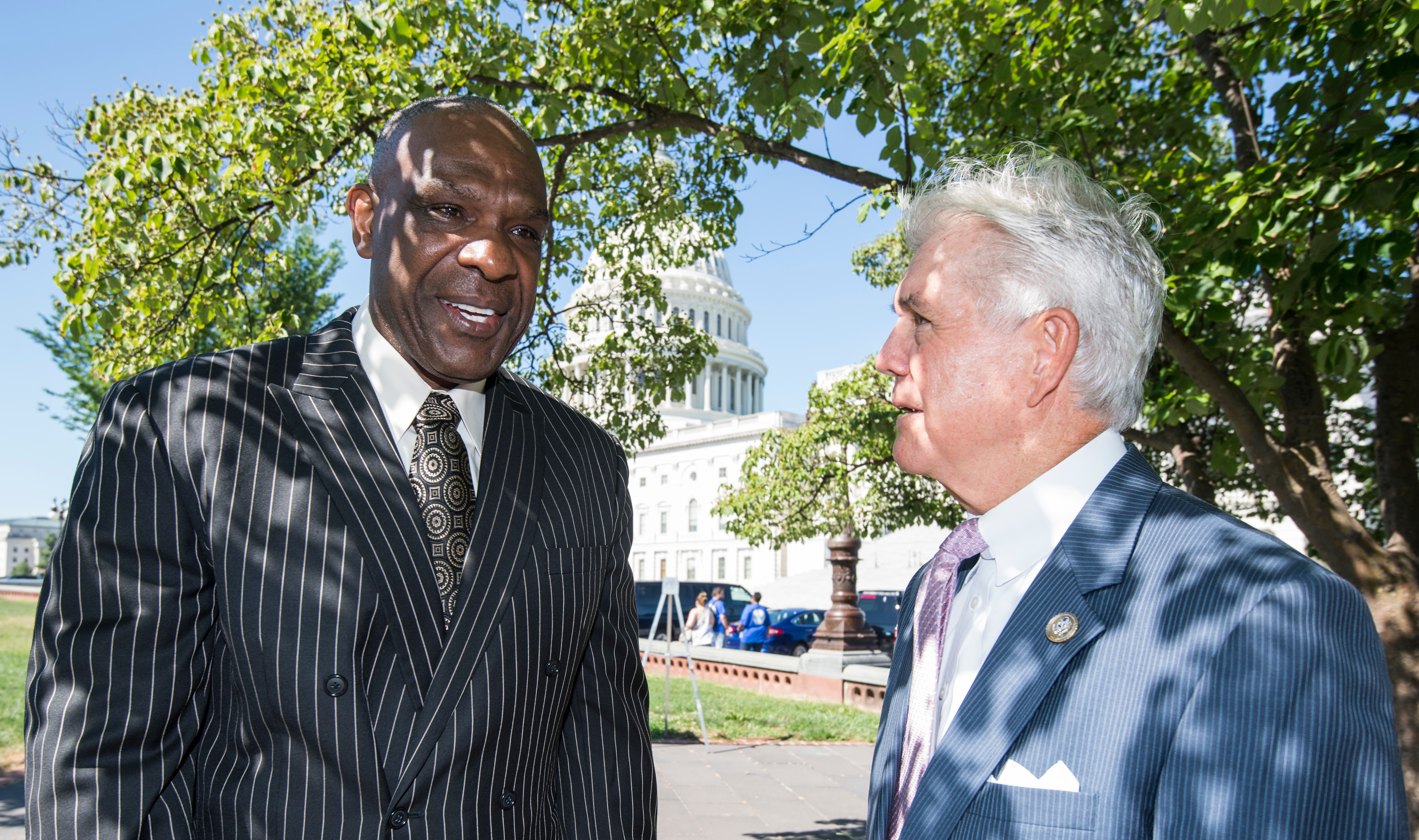 UNITED STATES - JULY 18: From left, baseball Hall of Famer Andre Dawson and Rep. Roger Williams, R-Texas, talk before their press conference outside the Capitol on Wednesday, July 18, 2018, commemorating the 75th anniversary of the integration of baseball. In honor of the anniversary, members of Congress are pushing for the Integration of Baseball Commemorative Coin Act which will authorize the United States Mint to create a commemorative coin to honor those who fought for the integration of baseball. (Photo By Bill Clark/CQ Roll Call)