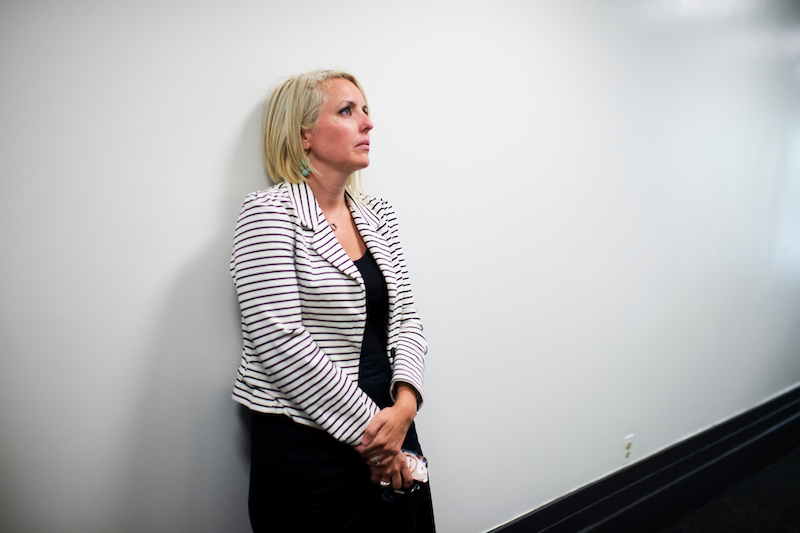 Katie Patru stands outside of a news conference in the Capitol, June 11, 2014, as her the boss, House Majority Leader Eric Cantor, R-Va., announces he will be stepping down after a stunning election loss. (Photo By Tom Williams/CQ Roll Call)